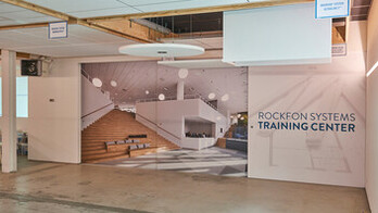 BE, Wijnegem Rockfon training center, installation room, photo wall and training center name