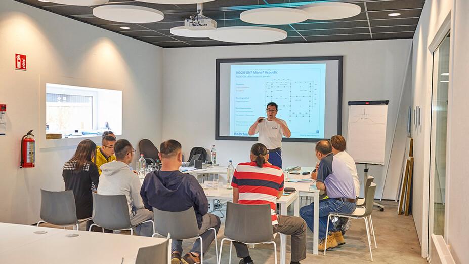 BE, Wijnegem Rockfon training center, theoretic training, class room, presenter, powerpoint presentation, installers attending theory program